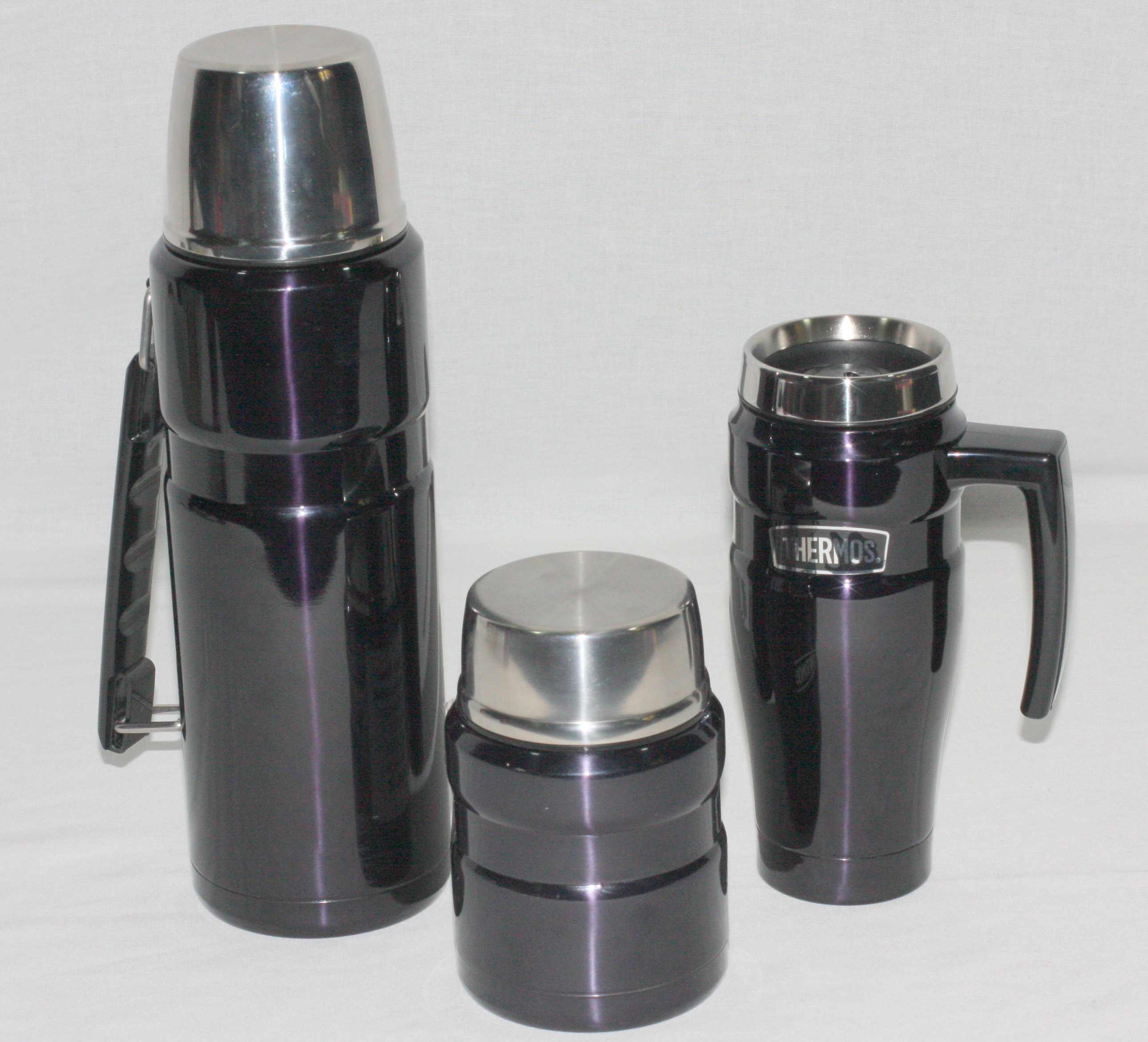 1.2 Litre Stainless Steel THERMOS flask Food jar and Travel Mug in Midnight Blue This is a special offer of a 1.2 litre Midnight Blue Thermos Flask plus a 500 ml spill proof travel mug and a 470 ml Food Jar with a stainless steel spoon. All of these products are stainless steel and vacuum insulated for maximum heat or cold retention for the longest period.