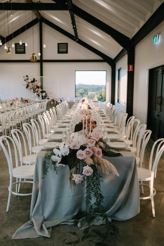Cascading wedding flowers table Byron Bay