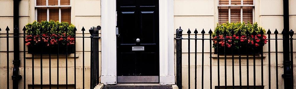 black-front-door-between-front-fence-jpg