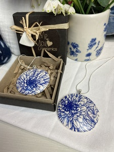 Blue and White Floral Print Domed Pendant on a silver plated chain.