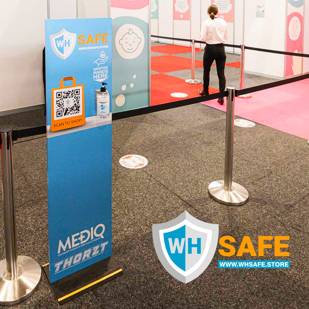 Image of a hand sanitising station with text underneath that reads WH Safe Sanitisation Stations Hand sanitising stations will be featured throughout our Expos to encourage good hand hygiene.