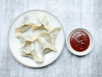 Gingergirl Aromatic pork dumplings with gochujang sauce (6 pieces)