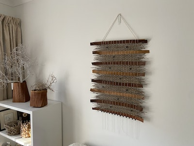 Wall hanging with wooden beads