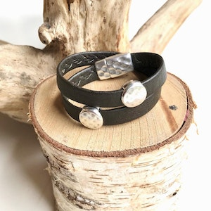 Reindeer leather double wrap bracelet with 2 silver hammered discs and a magnetic clasp.