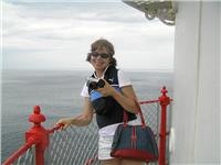 GoSeeAustralias Lisa gets high on the Cape Otway Lighthouse Vic