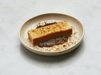 Tres leches - Authentic Peruvian vanilla sponge cake, red berry coulis, hazelnut praline.