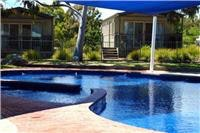 Shaded solar  heated swimming pool at Great Aussie Holiday Park.