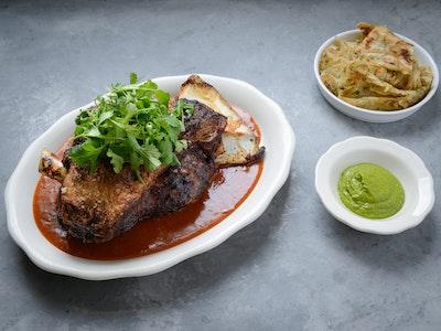 Slow-cooked Xinjiang lamb, spring onion pancake, coriander & mint sauce. Serves 2, $24 per person.