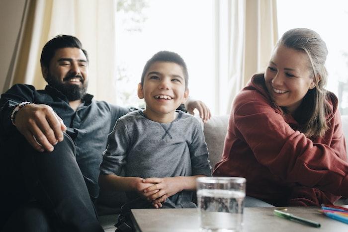young-boy-sitting-between-his-parents-jpg