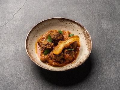 Beef kefta, tomato, saffron & smoked eggplant tagine, freekah