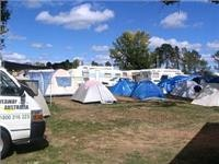Tents and caravans abound and take all vantage points