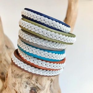A wider traditional Sami braided leather bracelet.