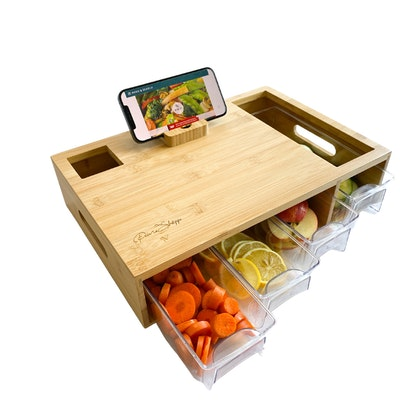 PrimaShoppe Multi-function Large Natural Bamboo Cutting board with food trays and phone stand.