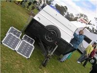 Solar  panels top up battery power on this Heaslip camper