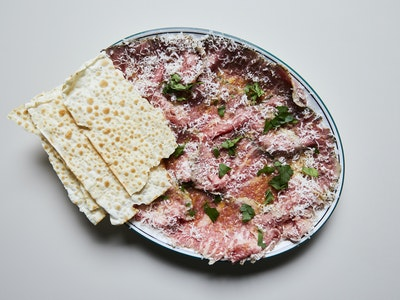 """The Hardware Club Roast-Beef Sirloin """"Carpaccio"""", Valdese Bay Leaf Rub, Drippings mayo and Parmigiano."""