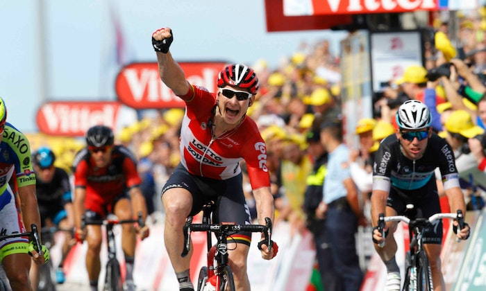 Andre Greipel Stage 2 crosses the line first