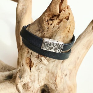 Reindeer leather double wrap bracelet with a intricate magnetic clasp.