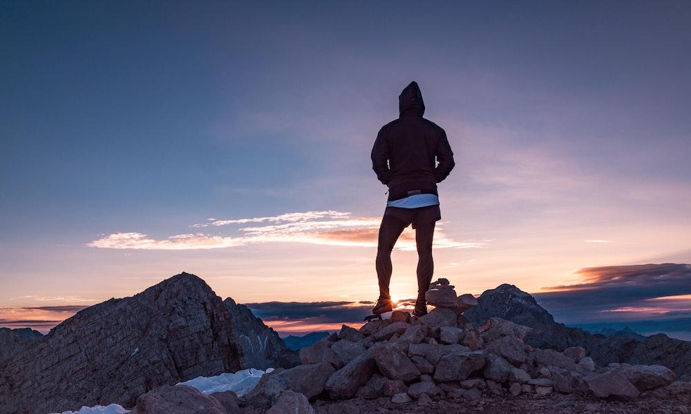 climber-standing-on-mountain-1-of-1-jpg