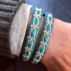 Sami braided leather double wrap bracelet, with sterling silver beads and magnetic clasp.