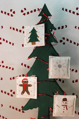 Julevidge Christmas hanging decorations, handmade and hand printed finished with free motion embroidery. Include a snowman, snowflake, gingerbread   and Christmas tree..
