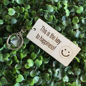 """""""This is the key to happiness! :)"""" Quirky Timber Keyring - Laser Cut & Etched on Timber with Silvertone Hardware finished with a LLL Logo Tag."""