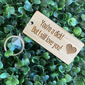 """""""You're a dick! But I still love you!"""" Quirky Timber Keyring - Laser Cut & Etched on Timber with Silvertone Hardware finished with a LLL Logo Tag."""