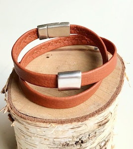Reindeer leather double wrap bracelet with a silver rectangular slider and a magnetic clasp.