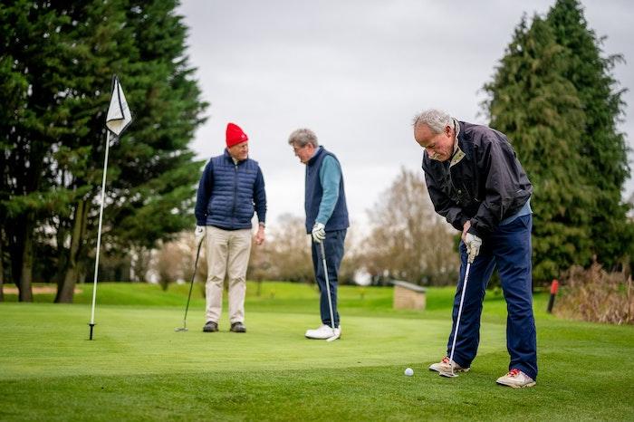 men-playing-golf-jpg