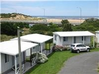 Cabins with an outstanding location courtesy Great Ocean Road Caravan Park, Peterborough.
