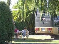 Kick back with the Biguns parked Miranda Holiday Park Waitakaruru