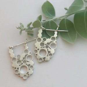 Oval lace silver hoops