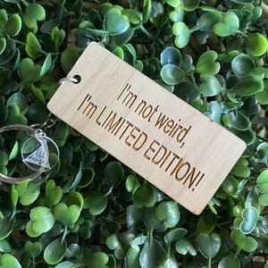 """""""I'm not weird, I'm LIMITED EDITION!"""" Quirky Timber Keyring - Laser Cut & Etched on Timber with Silvertone Hardware finished with a LLL Logo Tag."""