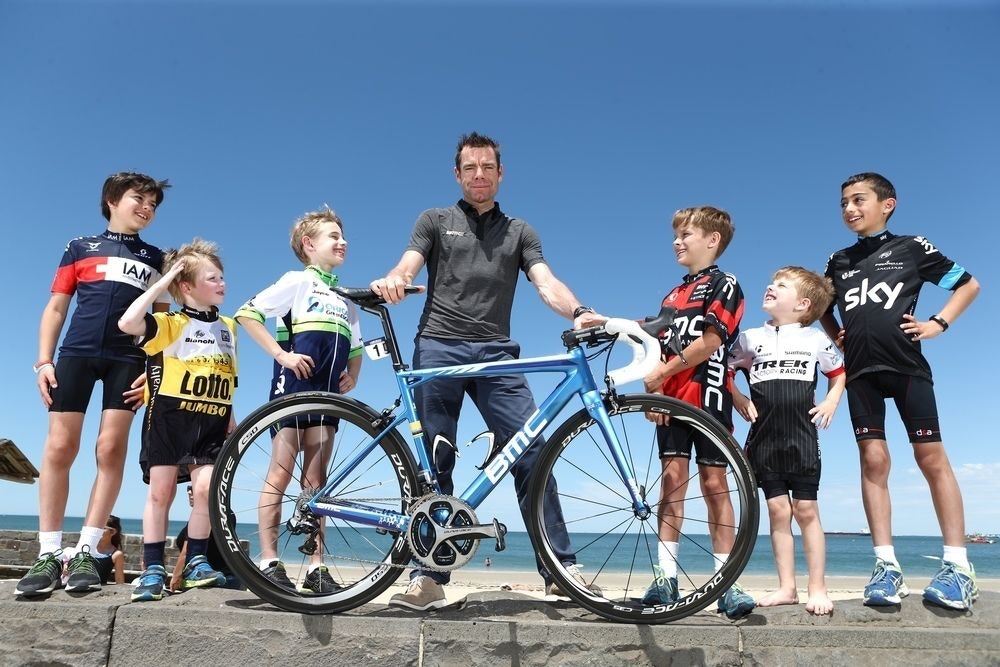 fullpage Cadel with kids on bike