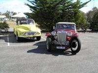 MG TC sports  leads the Morris convertible to the line