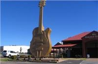 GoSeeAustralia parks  beside the  12m  Tamworth Golden Guitar