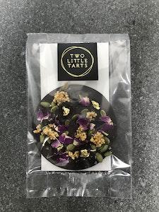 Dark Chocolate Ring, caramelized quinoa, cranberry, pepita, rose petal, gold leaf.