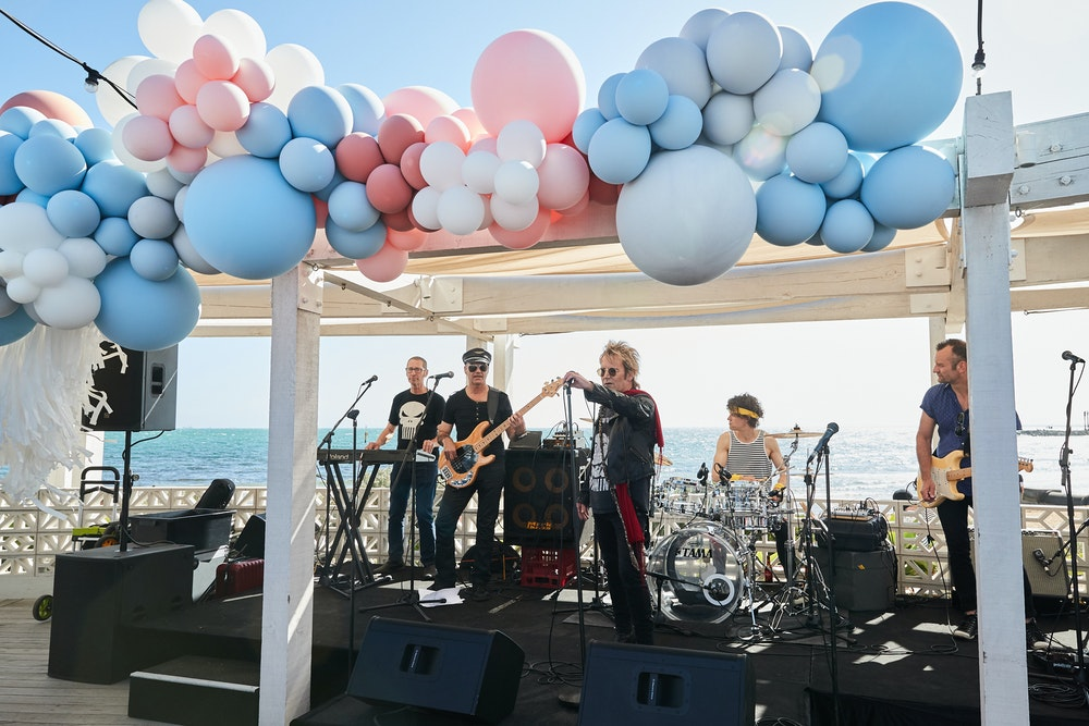 Peach and pale blue 50th birthday party by the beach