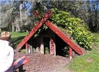 Buried Village -Te Wairoa Rotorua.  The carving is original  GoSeeNZ pic