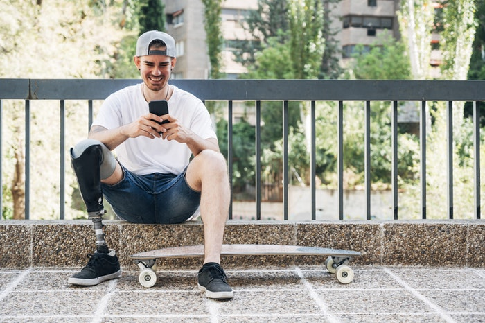 young-man-with-skateboard-on-phone-jpg