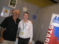Happiness is mutual for Marcus and Amanda on the AAA Tourism stand