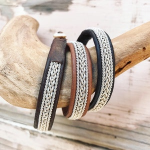 Sami braided leather bracelet with pewter borders.