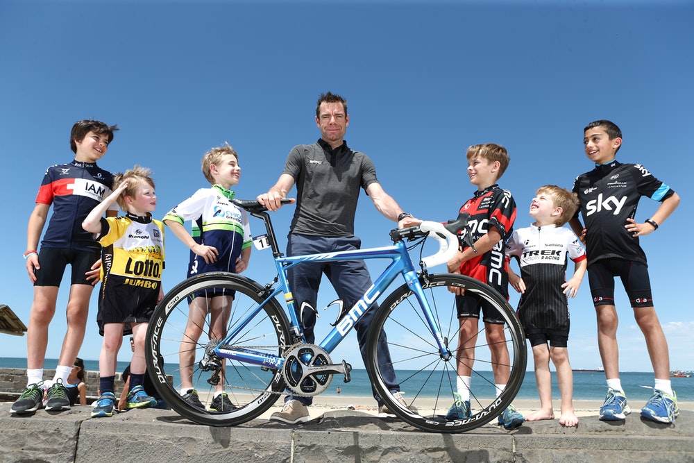 Cadel with kids on bike