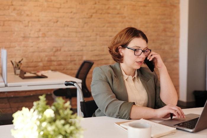 woman-on-phone-working-on-laptop-jpg