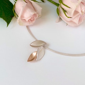 Rose gold 3 leaf necklace on multi strand cable