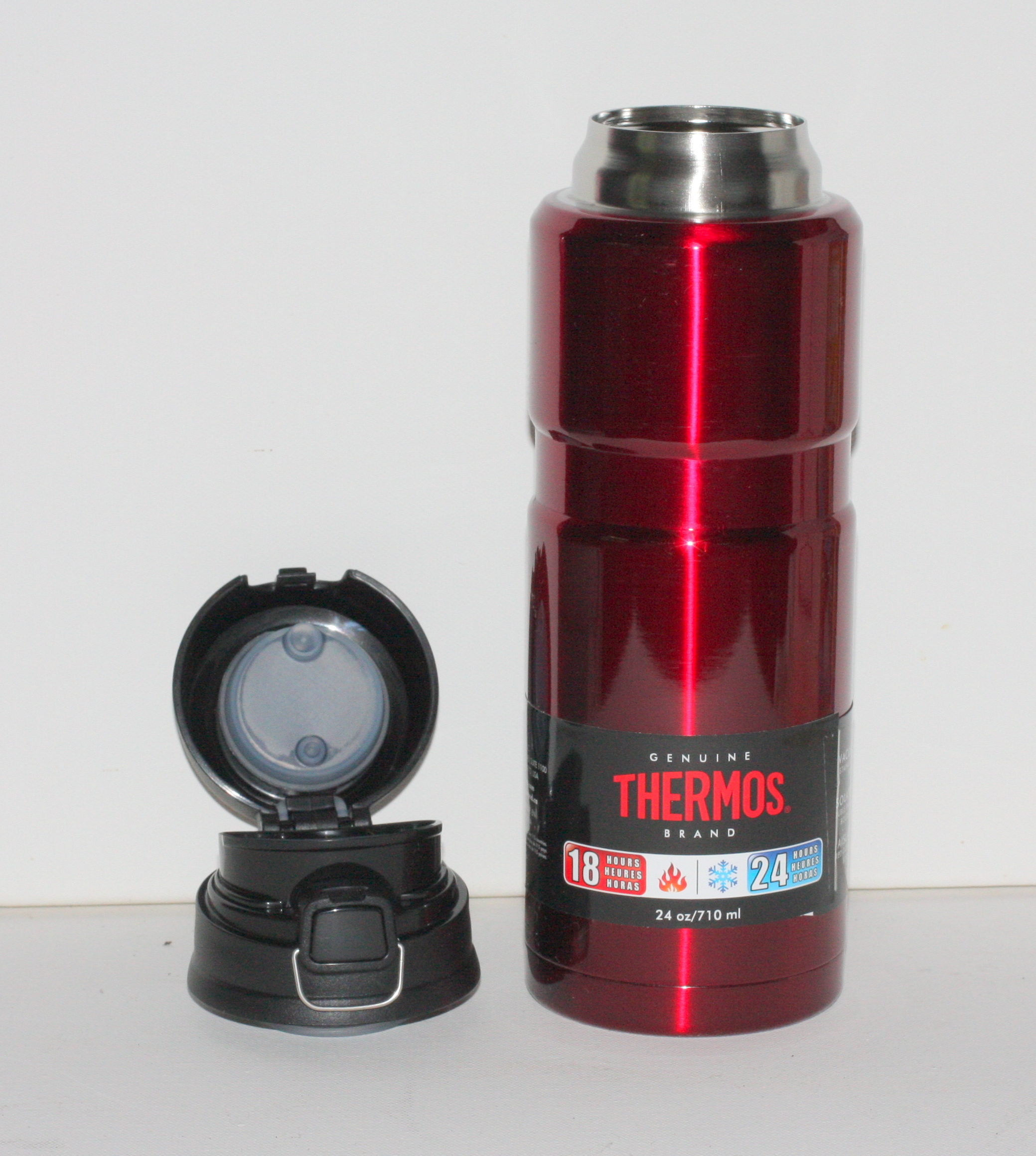 Red personal THERMOS Flask with a flip top lid This is a 710 ml RED stainless steel, vacuum insulated beverage bottle for both hot and cold liquids.