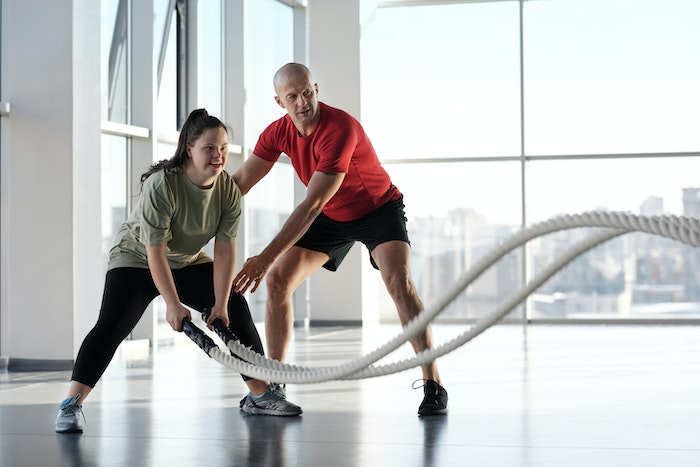 young-girl-working-out-with-trainer-jpg
