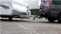 Autobacking system holds line when caravanners hit reverse
