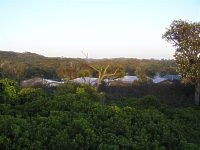 Sheltered cabins in sound of the surf, One Mile Beach Holiday Park, Port Stephens