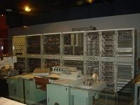 CSIRAC command console with teletype terminals and Racks Behind