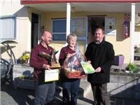 Mayor Ian McKelvie presents a certificate of appreciation to Margaret and Dennis